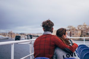 showing couple wearing mask on a boat